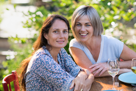 Portrait of two beautiful women in their forties. complicity and smiles