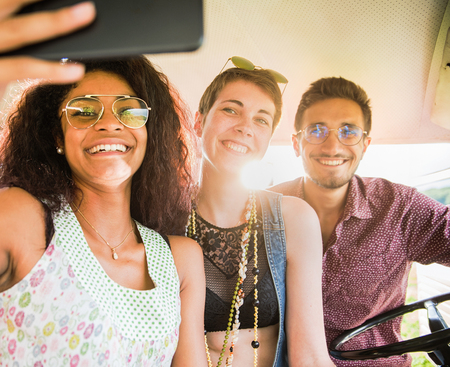 Mixed group of happy young people having fun doing a selfie Stock Photo