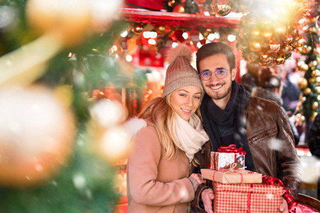 Christmastime. A young couple shopping for Christmas Stock Photo