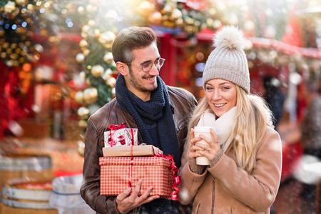 Christmastime. A young couple shopping for Christmas Stock Photo