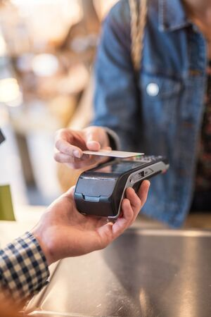 Focus on a contactless card payment with the terminal