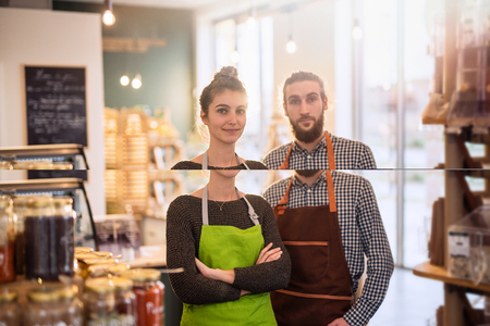 Portrait of a young couple owner of their food store Imagens