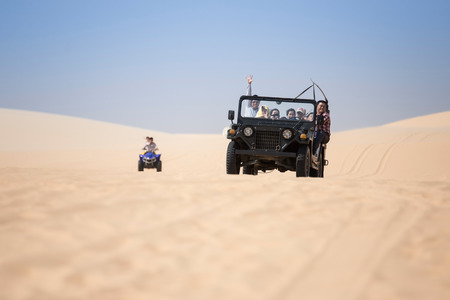 ne: MUI NE - VIETNAM, APRIL 20 : Tourists enjoy on the desert by jeep car in mui ne, April 20, 2015