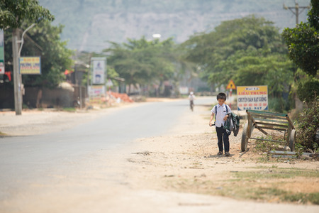 ne: MUI NE - VIETNAM, APRIL 20 : Student were walking come back from school in mui ne, April 20, 2015 Editorial