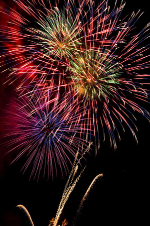 Green colorful fireworks in black background Stock Photo