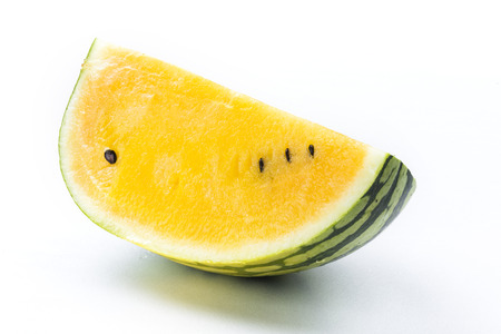 sliced watermelon: Slice of yellow watermelon isolated on a white background