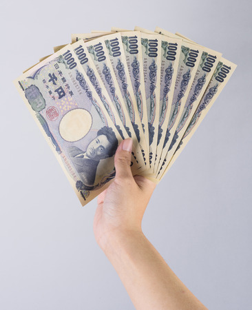 Closeup of Japanese currency yen bank notes Stock Photo