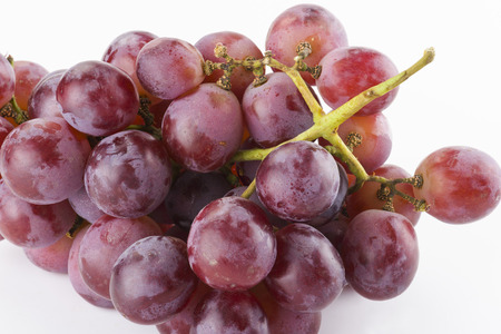 Ripe red grape isolated on white background.