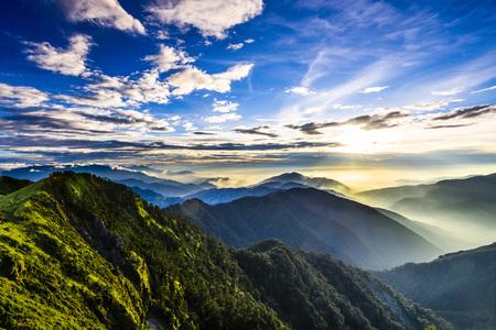 Majestic sunset in the mountains landscape. Nantouin Hehuan, Taiwan, Asia. Archivio Fotografico