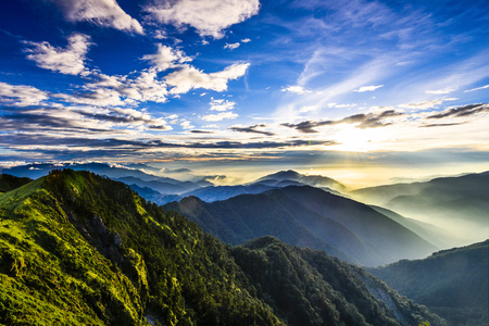 Majestic sunset in the mountains landscape. Nantouin Hehuan, Taiwan, Asia.