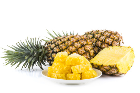 Slice of pineapple on white dish