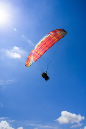 Paragliding extreme Sport with blue Sky and clouds