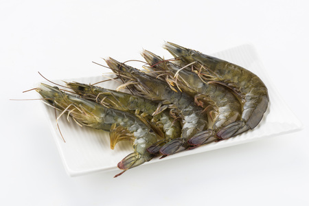 Raw shrimp on white background 免版税图像