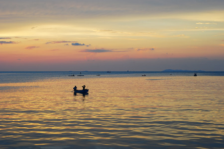 sailling: Silhouette of a couple sailling boat while sunsets with twilight colourful sky