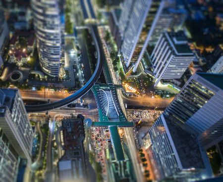partment: Aerial view from top roof, tilt-shift effect of Central Business district, CBD of Bangkok on Sathorn road