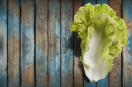 nappa: Napa or Nappa cabbage on wooden background. Chinese cabbage, Brassica pekinensis Stock Photo