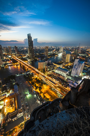 Aerial view at sunset landscape of Bangkok city skyline with very long bridge cross the river