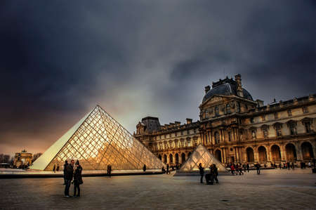 PARIS - January,1st 2016: The Louvre, view of famous Louvre Museum with Louvre Pyramid, one of the largest museums in the world and one of the major tourist attractions of Paris.