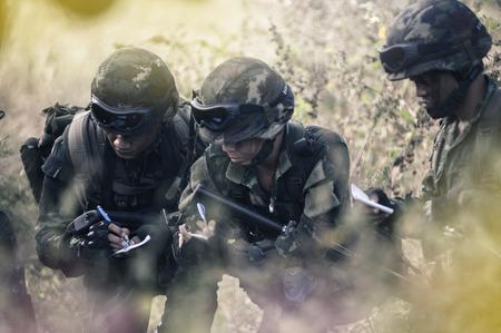 commander: PRANBURI, THAILAND - November 25, 2016 - Military Rangers team in training, plan to attack the enemy