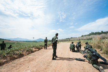 M16: Thai Army Soldiers with full uniform preparing to carry patient to the aircraft, military training Editorial