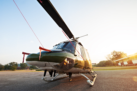 navy blue background: Thai Army Helicopter is parking at the hangar in the morning with sunrise