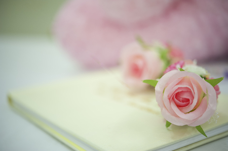 Guest book in wedding party and pink rose