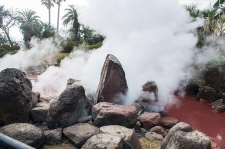 Hot spring water (Hells), red pond in Umi Jigoku at Beppu, Oita-shi, Kyushu, Japan.