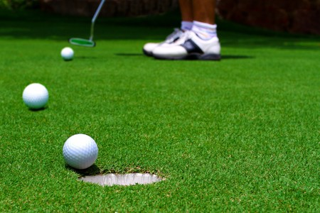 Three golf ball on green
