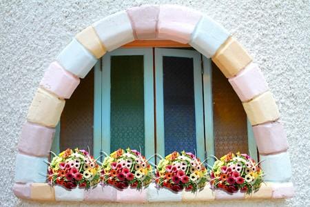 Brickbat window with beautiful flowers photo