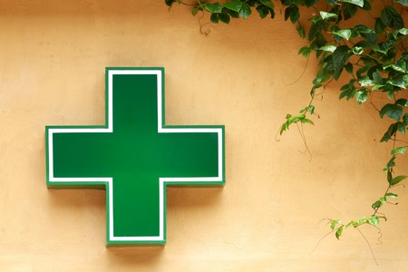 hospital staff: Green medical cross sign