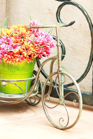 old golden bicycle with flowers in basket photo