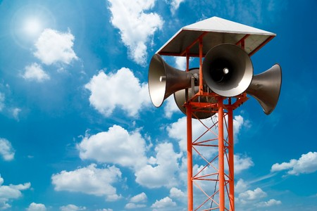 Lots of loudspeakers on a tall