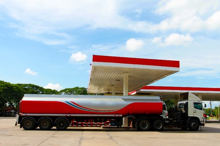 empty tank: Red fuel truck in gas station