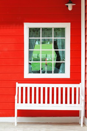 old window: White chair against white window and red wall