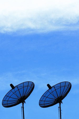 Two Satellite Dish and blue sky photo