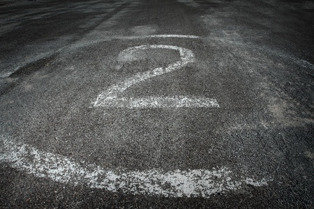 number 2 painted on pavement  photo