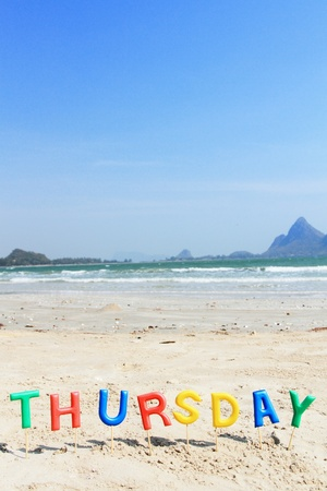thursday: Alphabet  forming the word thursday and sea view background