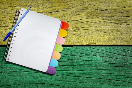 Open note book on wood background  photo