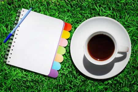 Note book and cup of coffee  photo