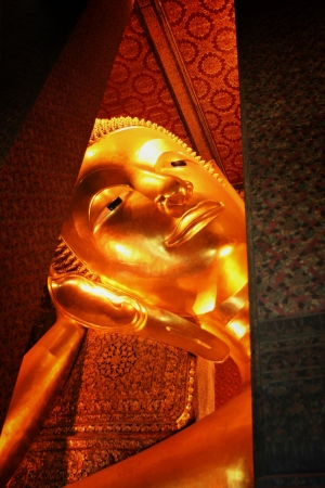 The golden Buddha in Wat Pho Bangkok, Thailand  photo