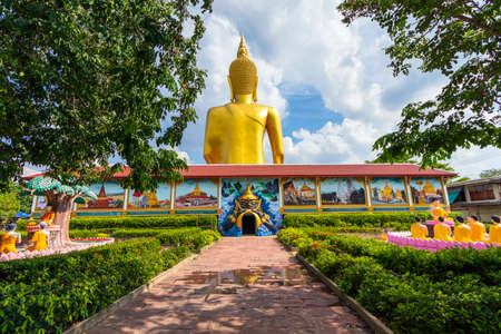 The large golden Buddha statue at Bang Chak Temple, which is an important tourist attraction of Nonthaburi Province in Thailand