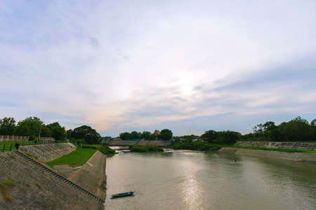 View of the Pasak River behind the Rama VI Dam in the evening.