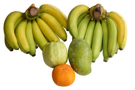 Bananas and various fruits are isolated on a white background.