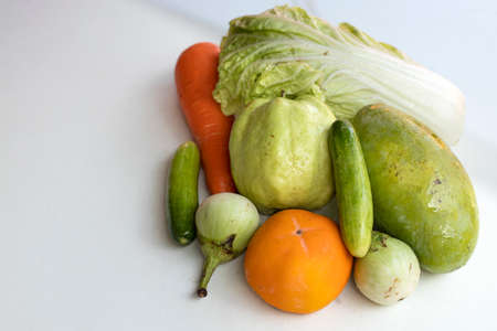 Fresh fruits and vegetables on a white background