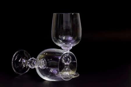 An empty wine glass on a black background