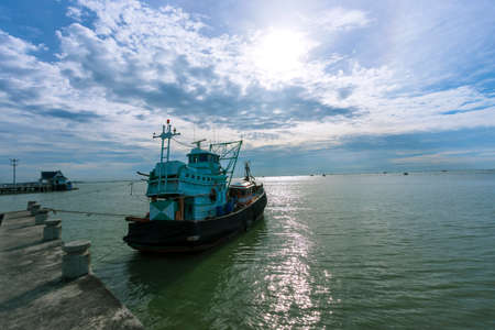 Beautiful sea scenery with fishing boats parked by the sea, Chon Buri, Thailand