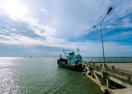 Local fishing boats moored along the coast in Chonburi Province. Stock fotó