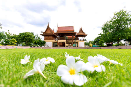 Beautiful Thai style house in a beautiful garden and lawn with azalea flowers.