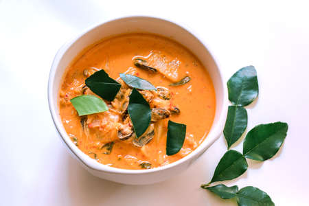 Mussel curry, put pineapple, Thai food in a bowl on a white background