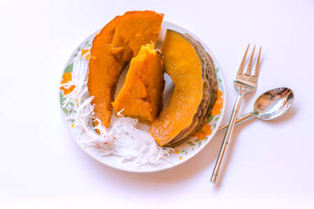 Steamed Pumpkin Snacks On A Plate On a white background